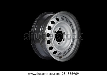 Car alloy wheel, isolated on black background.
