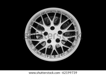 Car alloy wheel, isolated on black background