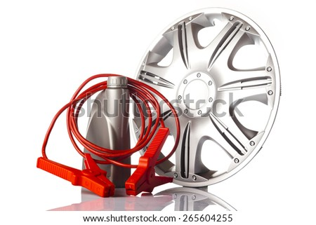 Car alloy wheel, motor oil with  jump start cable isolated on white - stock photo