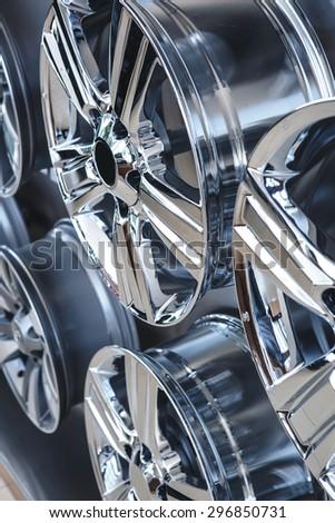 Car alloy wheels close up - stock photo