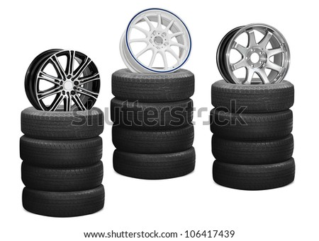 car alloy wheels on pile tires isolated on white background save paths for design