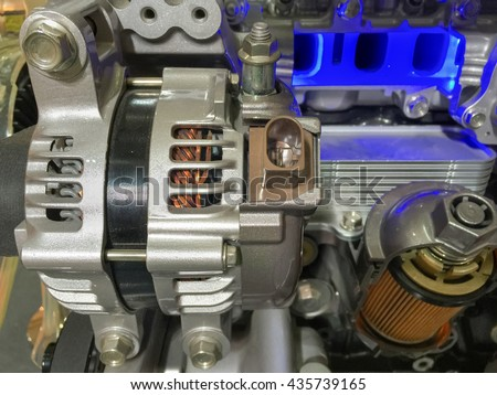 Car alternator and engine oil filter cross section , display inside materials. - stock photo