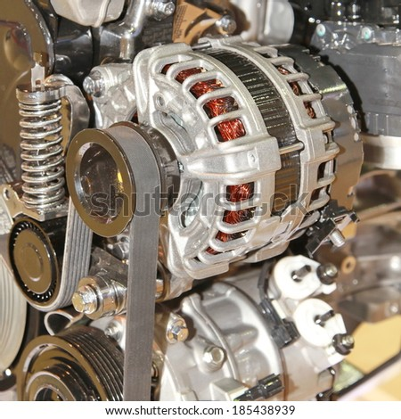 Car alternator, Converting Mechanical Energy to Electrical Energy Inside a Car. - stock photo
