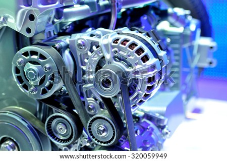 car alternator with drive belt. - stock photo