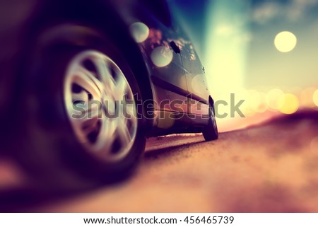 Car and automotive concept.Abstract background speed in auto.Tire and wheel in the road. Driving fast.Trip and road .Drive in scenery sunset.Car wheels and tire detail.  - stock photo