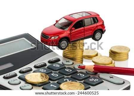 car and calculator. rising costs for car purchase, lease, service, refueling and insurance - stock photo