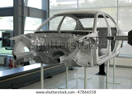 Car and coordinate measuring machinesat the Production Line - stock photo
