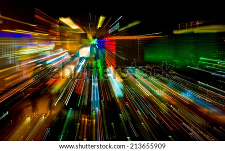 Car and hotel lights with long exposure at night from above. - stock photo