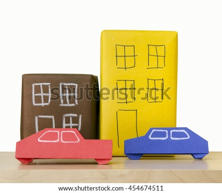 car and house made of paper folded Japanese technique of origami - stock photo