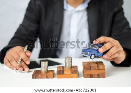 car and money. concept of car loan, Rent, car insurance, buy car Toy car and money over white - stock photo