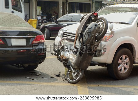 Car and motorcycle collided on the road. - stock photo