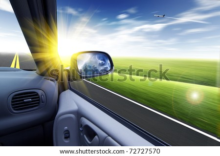car and rear view mirror - stock photo