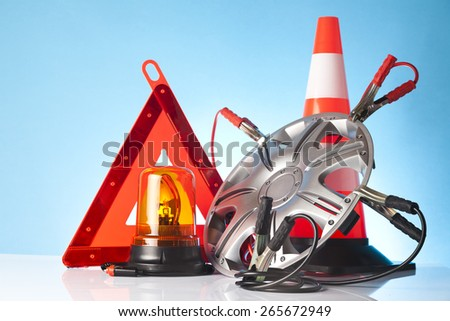 car and road emergency accessories on blue background - stock photo