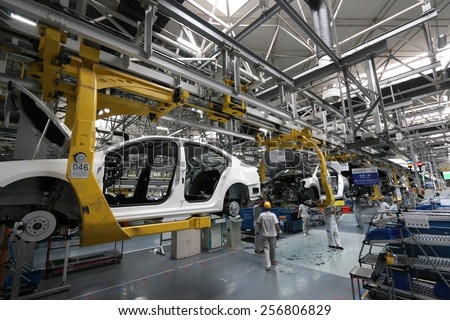 Car Assembly Plant in Chengdu, China - September 19, 2014. Chengdu economic growth. State-level economic and technological development zone of Chengdu. - stock photo