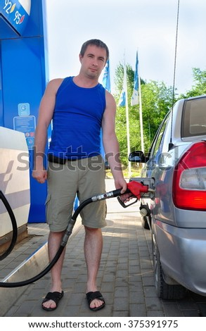 Car at a gas station fueled - stock photo