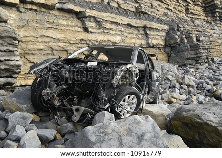 Car at bottom of cliff - stock photo