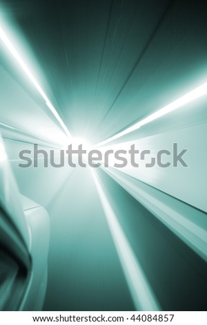 Car at high speed towards the light - stock photo
