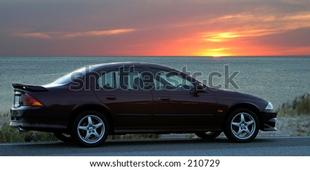 Car at the beach at sunset...