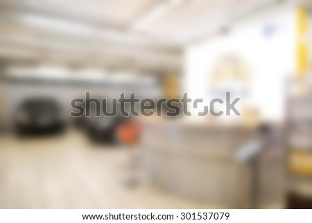 Car auto dealership themed blur background with bokeh effect - stock photo
