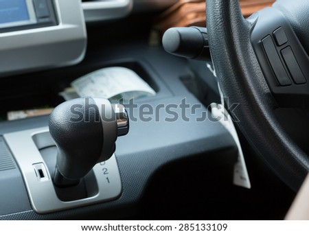 car automatic gear with black steering wheel - stock photo