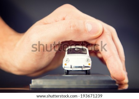 Car (automobile) insurance and collision damage waiver concepts. Businessman with protective gesture. - stock photo