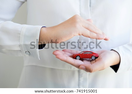 Car (automobile) insurance and collision damage waiver concepts. Businesswoman with protective gesture and car.  solution for the best protection