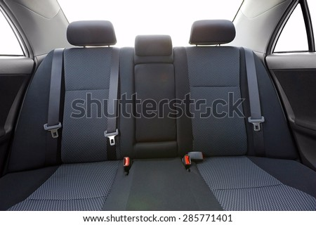 Car backseats with intentional light flare from the burnt out background - stock photo