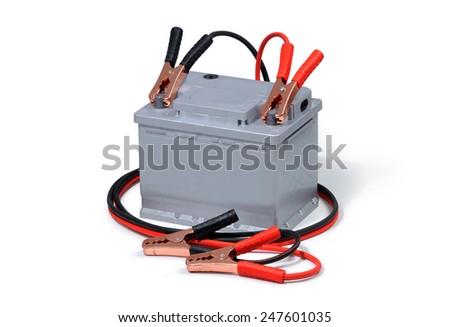 Car battery and jumper cables isolated on white background. - stock photo