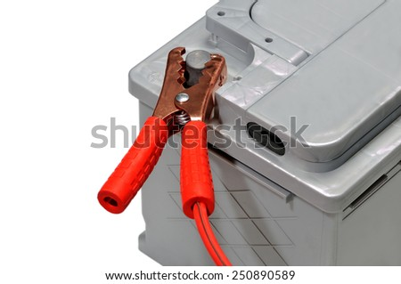 Car battery and red jumper cable isolated on white background. - stock photo