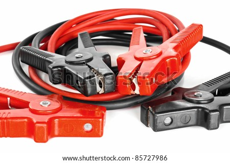 Car battery jumper cables over white background - stock photo