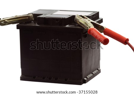 car battery with electrical leads clipped on to the terminals - isolated over white