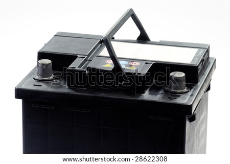 Car battery with electrical leads clipped on to the terminals - isolated over white background - stock photo