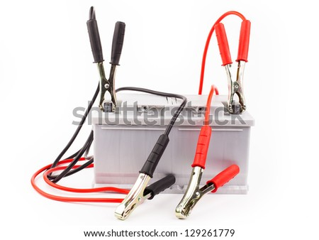 Car battery with two jumper cables clipped to the terminals isolated on white - stock photo