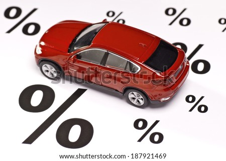 Car between percent signs as a symbol of discount. - stock photo
