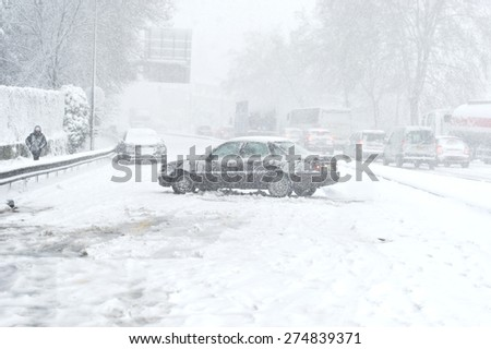 Car blocked caused by heavy snowfall - stock photo