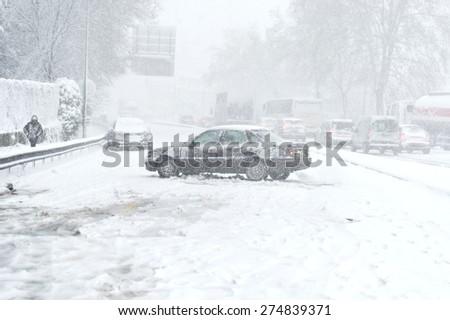 Car blocked caused by heavy snowfall - stock photo