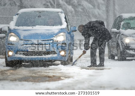 Car blocked on an highway caused by heavy snowfall - stock photo