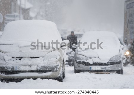 Car blocked on highway caused by heavy snowfall - stock photo