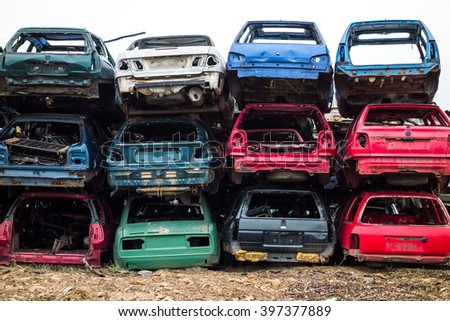 Car bodies stacked at the junkyard - stock photo