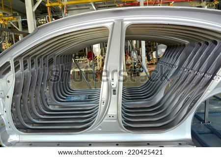Car body sidewalls in welding shop of the automobile enterprise - stock photo