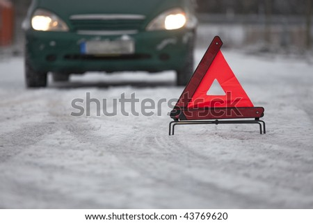 car breakdown with warning triangle on the road - stock photo