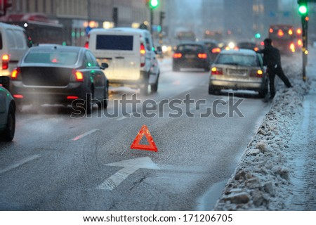 Car broken down, out of fuel in the snow storm - stock photo