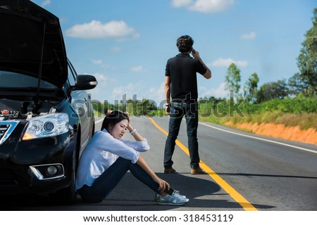 Car broken street Man telephone call insurance. She had a stress - stock photo