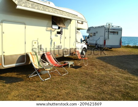 car caravan and chairs  - stock photo