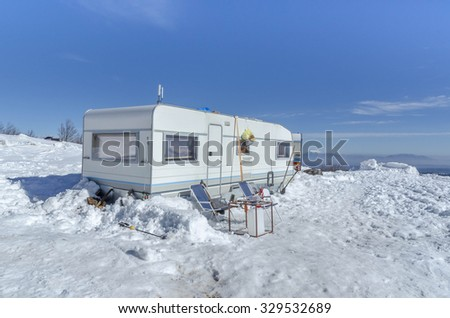 car caravan snow, winter - stock photo