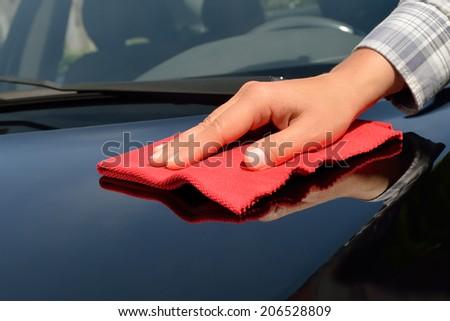 Car Care - Polishing a black Car - stock photo