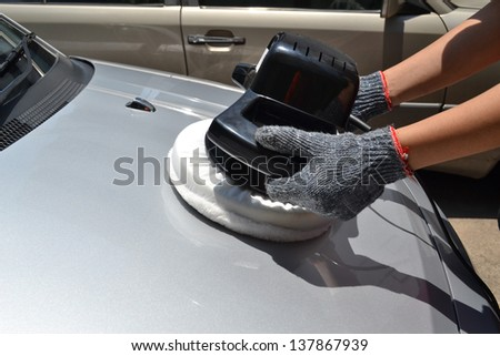 Car care with power buffer machine at service station - a series of CAR CARE images. - stock photo