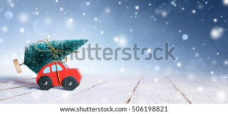 Car Carrying Christmas Tree With Snowfall