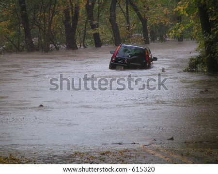 Car caught in flash flood waters from the Perkiomen Creek, Pennsylvania - stock photo
