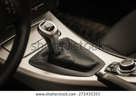 Car control knob and the gear change lever - stock photo